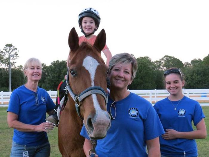 Volunteers with Horse